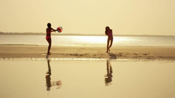 Multi ethnic girlfriends having fun on beach