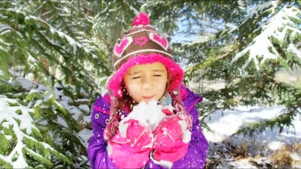 little girl having fun with snow