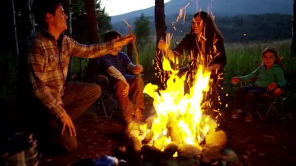 parents and children enjoying camping