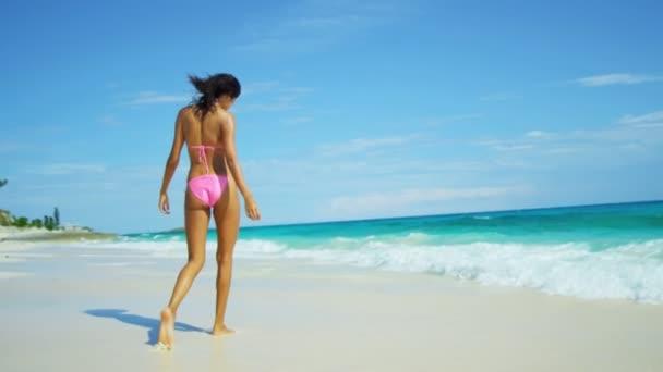 female in bikini on beach