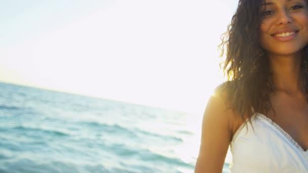 girl on luxury resort beach