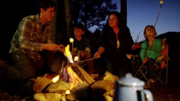 family toasting smores