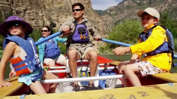 family enjoying rafting