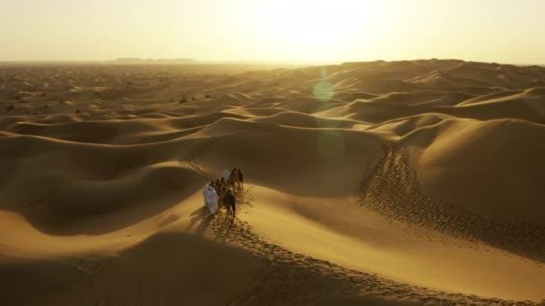 camel owners in desert convoy