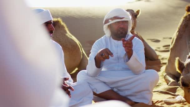 Camels  travelling across desert