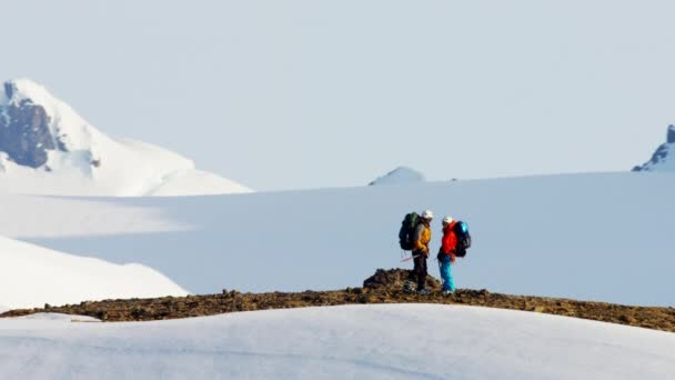 climbers crossing a snow covered mountain range