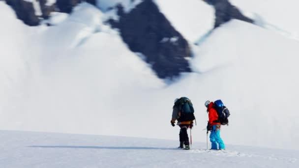 climbing team on Alaska mountain range