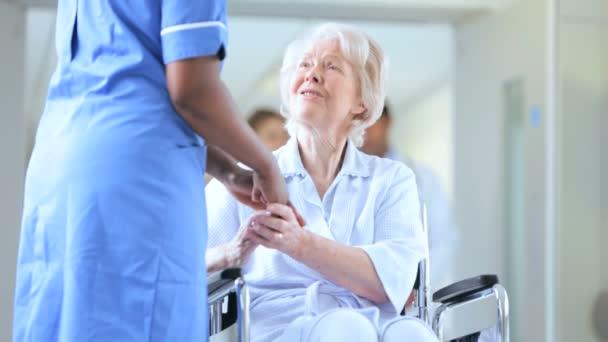 Close Up Medical Staff Talking Senior Female Hospital Patient