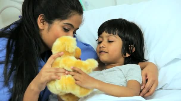 Nurse spending time with little girl