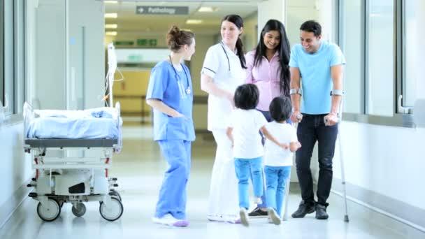 Nursing staff talking to male patient