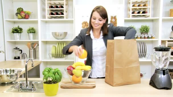 Smart Business Lady Unpacking Shopping Bag Fruit