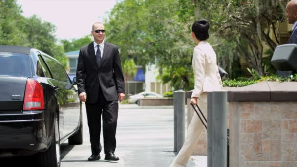 Limousine driver meeting ethnic company executives