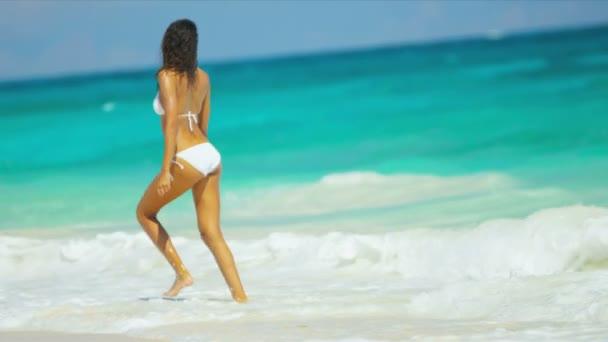 Woman in bikini having fun on beach