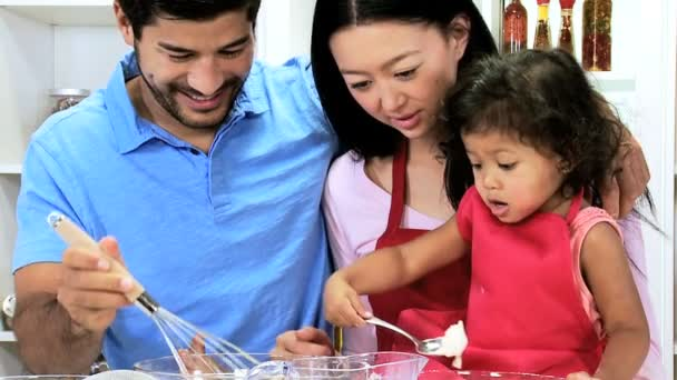 Couple with daughter preparing ingredients