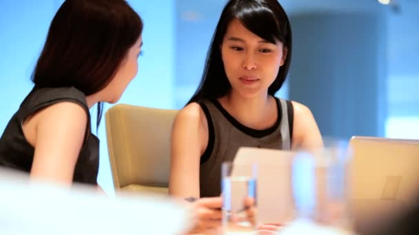 Businesswomen at Boardroom on conference planning business ideas