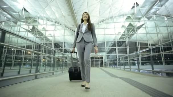 Asian businesswoman in airport terminal