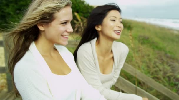 Women enjoying fresh air on beach