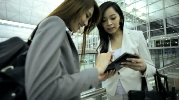 Asian businesswomen meeting in airport