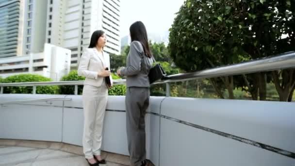 Businesswomen meeting and handshaking