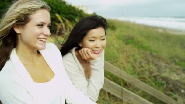 Women enjoying fresh air on beach
