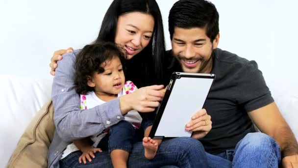 Couple playing games with daughter