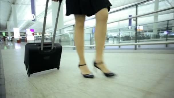 Businesswoman walking in airport terminal