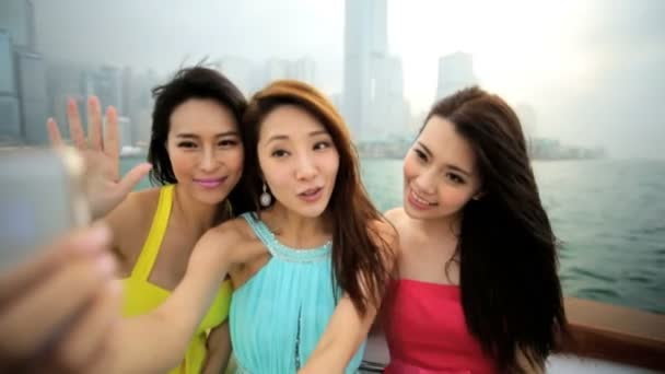 Girls taking selfie on yacht