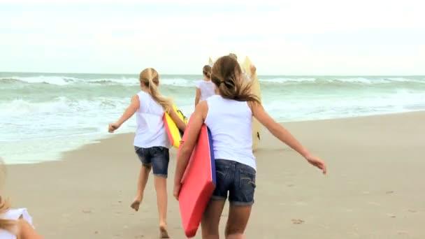 Family Enjoying Surfing Vacation