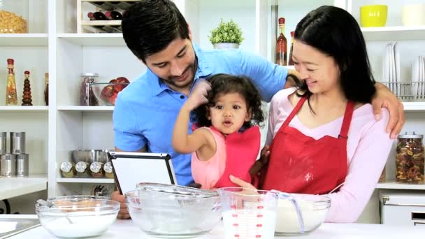 Couple with daughter at home kitchen