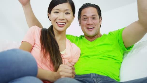 Couple Talking With Friends Via Laptop Webcam Stock Video