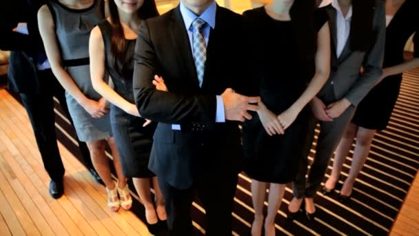 Male and  female Asian business consultants
