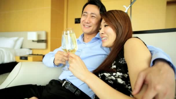 Young ethnic couple drinking champagne