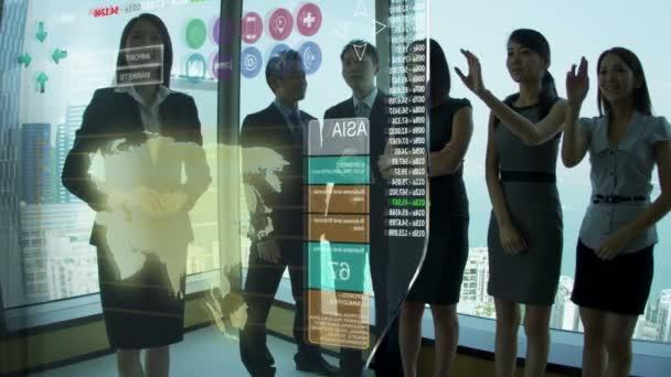 Asian Businessmen and Businesswomen using Motion Graphics Touchscreen