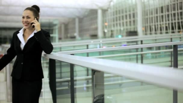 Caucasian businesswoman in airport terminal