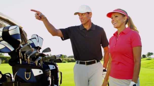 male and female golf players on golf course
