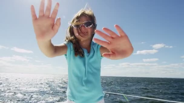 Young girl on luxury yacht in the ocean