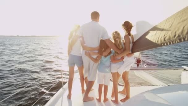 parents and daughters on luxury yacht