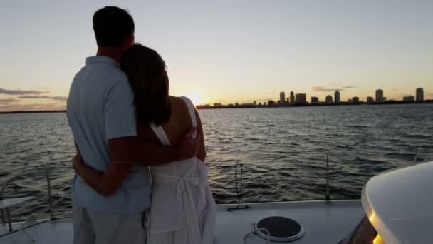 Couple looking  at Sunrise on Luxury Yacht