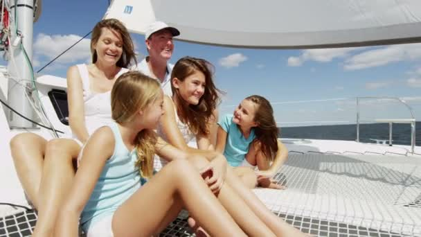 mother and father with smiling girls  on yacht