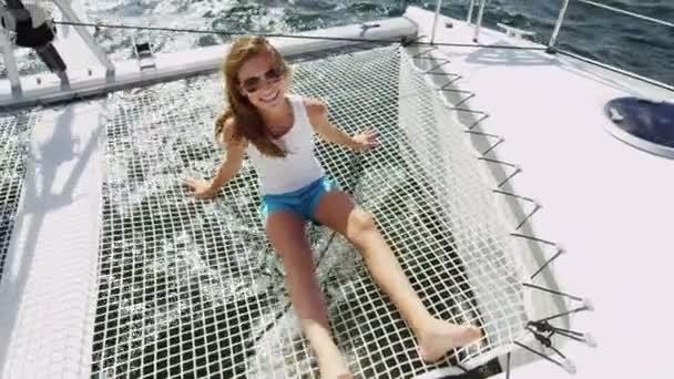 Young girl having fun on luxury yacht