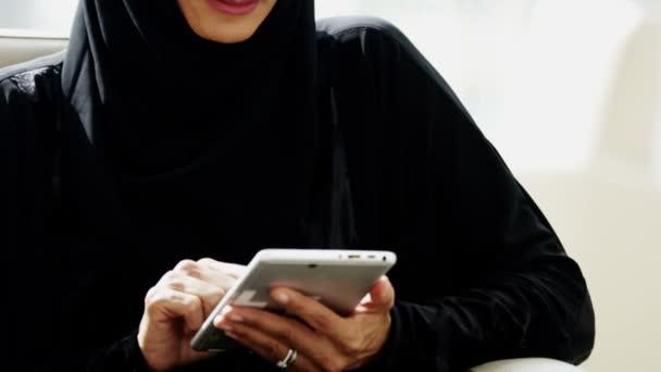 Arab businesswoman using digital tablet