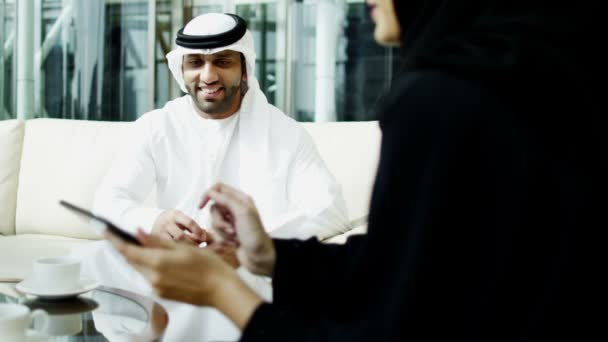 Arabic businessman and businesswoman meeting in hotel