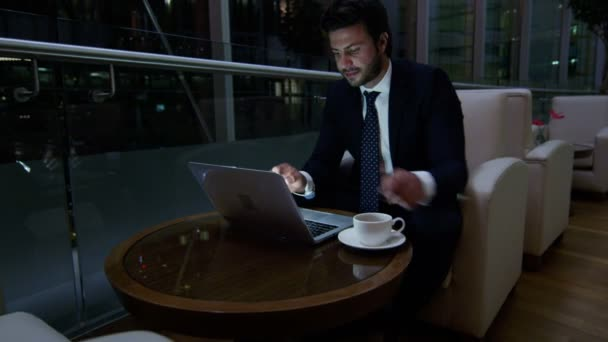Arabic businessman working on laptop at night