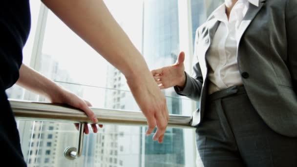 business women shaking hands after deal