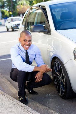 Young Black Inspector inspecting ,evaluating a car