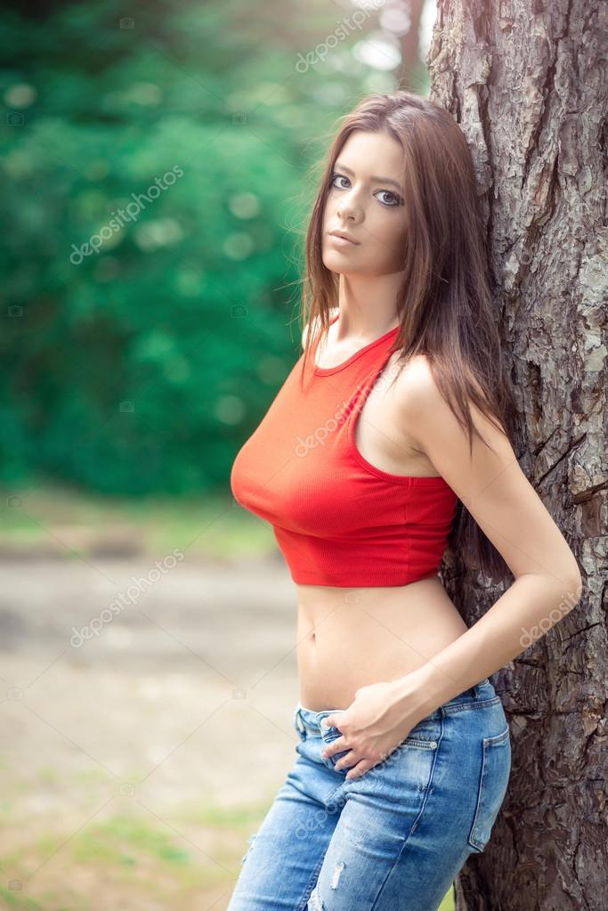 Female wearing jeans in forest