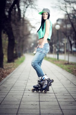 Girl roller skating in park