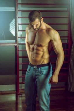 Man posing in jeans