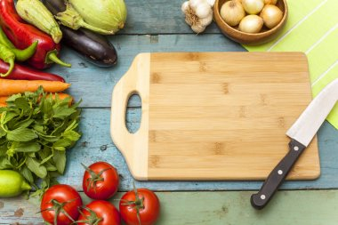 Assortment of fresh vegetables and chopping board
