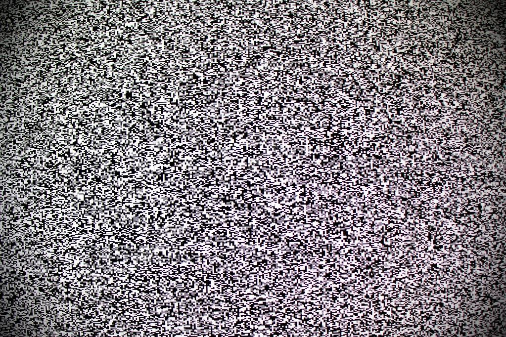 TV white noise on lcd screen — Stock Photo © Sergt #108901102